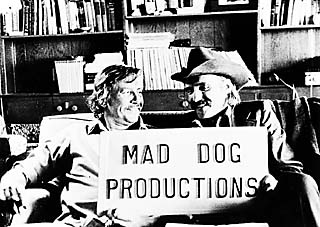 We would put that sign … we slapped it on the side of the van when we wanted to go somewhere -- when we were going to concerts and things like that -- and we'd just drive right in the back door, says Bud Shrake (l). Dennis Hopper starred in the movie <i>Kid Blue</i>, which Shrake wrote.