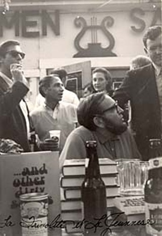 Holding a booksigning at Scholz Garten (in this case, for Larry L. King's  <i>… and other dirty stories</i> in 1968) is the epitome of Mad Dog style:  a little beer with your books. The man smoking behind King (seated)  is artist Fletcher Boone, and behind him, Bill Brammer.
