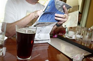 Breakfast beer at NXNW: The author checks the bus schedule.