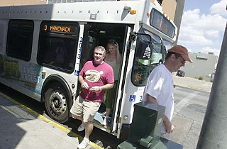 Pub crawlers hop off the bus Downtown.