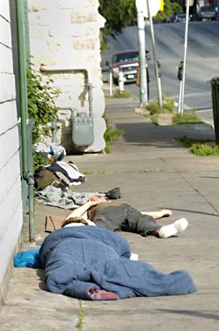 Homeless people sleeping on an East Seventh Street sidewalk