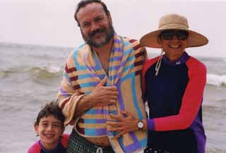 She married a slacker. Anne Lewis and Louis Black with son Eli.