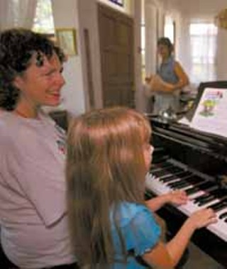 Michael O'Callaghan gives piano lessons to Duras Ruggles, who plays the Wigwam Song.