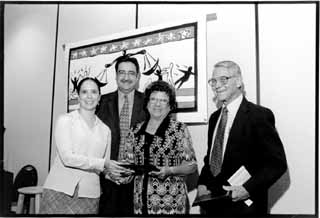 The Texas Civil Rights Project gave Henry B. González Civil Rights Awards (named in honor of the late Congressman) to labor organizers Maria Guadalupe Torres Martinez and Ed Krueger (far right), who have spent the past 20 years organizing maquiladora workers along the Rio Grande. State Rep. Pete Gallego (center), whose district contains nearly two-thirds of the Texas-Mexico border, emceed the award ceremony, which took place at the Hilton Austin North.