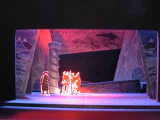 Inside Lonely Mountain, the lair of Smaug: Set design by J. Richard Smith for the Second Youth production of <i>The Hobbit</i>. Note side panels, which feature Tolkien's original illustrations for <i>The Hobbit</i> book jacket.