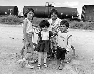 Children in Matamoros, Mexico, play in front of a railroad tanker carrying chlorine.