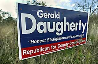 Pct. 3 Republican hopeful Gerald Daugherty is all about R.O.A.D. -- specifically, Reclaim Our Allocated Dollars, a nonprofit organization he founded in order to defeat Capital Metro's 2000 light-rail referendum. But in his bid for a seat on the Commissioners Court, has he forgotten that the roadside isn't his alone? Sprawling signs such as this one, located off the southbound access road of MoPac between Spyglass and Barton Springs Mall, are much larger than typical campaign signs. Some Austinites have contacted the <i>Chronicle</i> complaining about Daugherty's billboards. Signs posted in right-of-ways violate the city code.