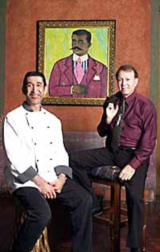 Fonda San Miguel's Executive Chef Miguel Ravago and owner Tom Gilliland in front of Daniel Brennan's <i>Zapata</i>, the first painting they bought for the restaurant