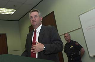 Assistant Police Chief James Fealy ends the meeting.