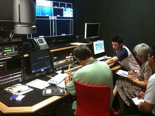 Instructor Mauricio Gonzalez (far right) leads an HD ministudio training class at channelAustin studios.
