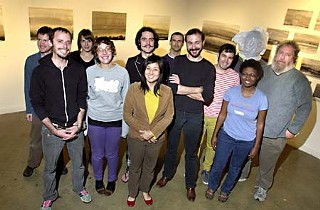 Salvage Vanguard Theater, November 2009: Aaron Mace (center, arms crossed), with volunteers (l-r): Paul Baker, Jeremy Hollinger, Amanda Lewis, Alissa DeRubeis, Bradford Kinney, Henna Chou, Jace  Toronto, George Pasterk, Nari M., unidentified,  Bob Bechtol