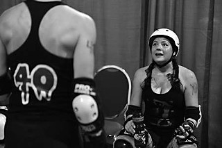 Cat Tastrophe (seated) of the Texecutioners talks strategy with teammate Bloody Mary.