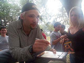 Touched by a Goonie: Corey Feldman signs autographs at last weekend's Ultimate <i>Goonies</i> Experience.