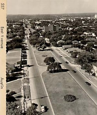 This undated photo, facing south, shows East Avenue before the construction of I-35. The four-lane boulevard was lined with houses on either side (you can also see Brackenridge hospital in the distance on the right) before it was replaced with the highway.