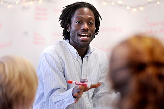 Poet and anthology editor Roger Reeves runs a workshop at Austin High.