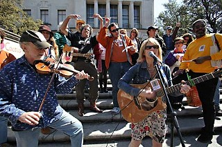 Musician Sara Hickman sings to the choir at last week's campus rally to save the Cactus Cafe.