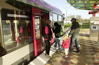"Passengers board Capital Metro's Red Line, which made its debut Monday. See ""<b><a href=http://www.austinchronicle.com/gyrobase/Issue/story?oid=oid%3A985788>You've Got Rail!</a></b>"""