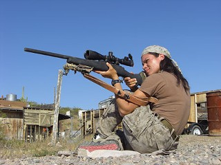 Melody Lopez scouts for snipers with the Leupold scope mounted on her bolt action rifle  (a .308 Remington 700 LTR) during an advanced sniper training course in Arizona.