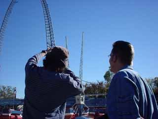Filmmaker Robert Rodriguez and Reel FX founder Dale Carmen discuss a shot on  location at Six Flags in Arlington.