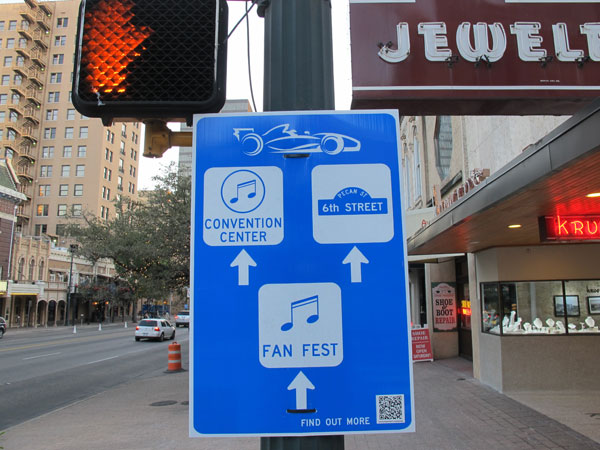 Watch for the swirly race car: New signs especially for visitors attending the United States Grand Prix have started cropping up around Downtown Austin.