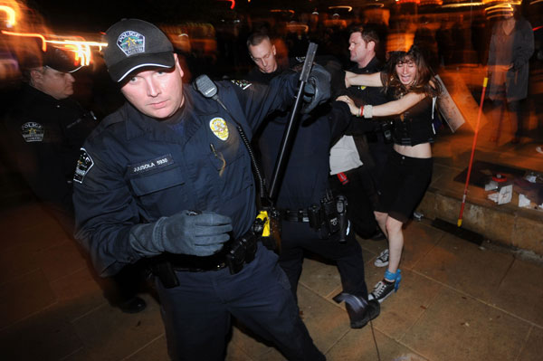Live streamer Corey Williams gets arrested as Natalie Atwater struggles to free him as Occupy Austin gets evicted from City Hall on February 3, 2012.