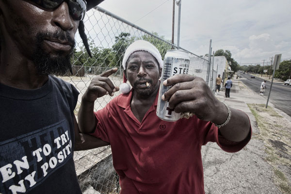 Life on the corner of 12th & Chicon: Michael Alexander and Nexhie enjoy a tall one.