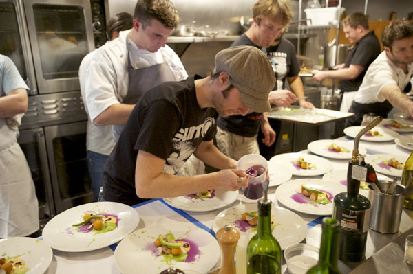 Chef Craig Thornton adds dried cherries to his rabbit dish