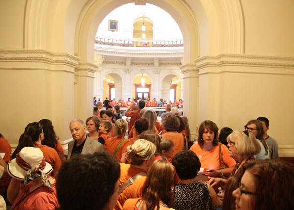 Protesters queue up more than an hour in advance to enter the House gallery to observe. Orange shirts continued to maintain a presence in the gallery until 4:30am, when the House adjourned after tentatively approving Senate Bill 5. The House reconvened later this morning and passed the bill.