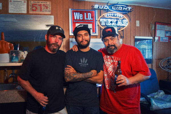 Kellee's Place bartender, Mikey Perez (center) with his uncle, owner Joe Perez (right), and a familiar face to fans of great barbecue, John Mueller (left), whose new trailer behind the bar is earning rightful raves