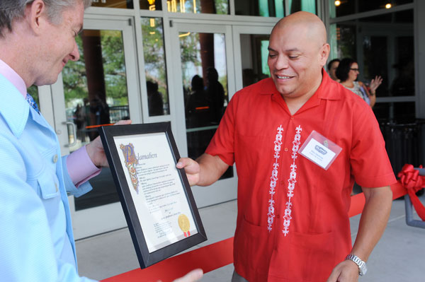 City Council Member Mike Martinez (r) presents a proclamation to Drafthouse CEO Tim League.