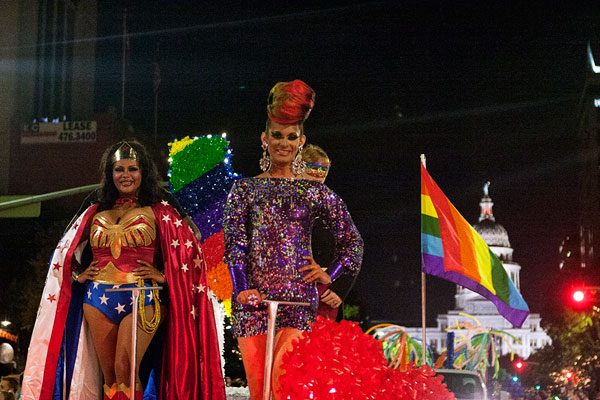 Kelly Kline (aka Wonder Woman) and Cynthia Lee Fontaine roll down Congress on the OilCan Harry's float in the 2013 Pride Parade