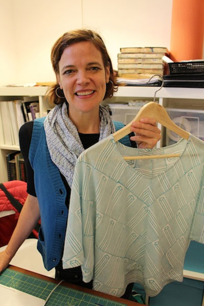 In this week's The Good Eye, Amy Gentry profiles Austin designer Rebecca Layton. Here, Layton holds up a hand-printed, bias-cut top from the Rekh & Datta sample line.