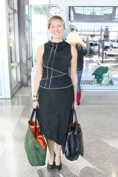 In this week's style column, the Good Eye takes a closer look at travelers' clothing trends.As president of GSD&M, Marianne Malina is more or less constantly flying, which explains her sleek, comfortable clothing and expertly packed olive-and-orange Herve Chapelier tote. (She has them, she says, in all colors.)